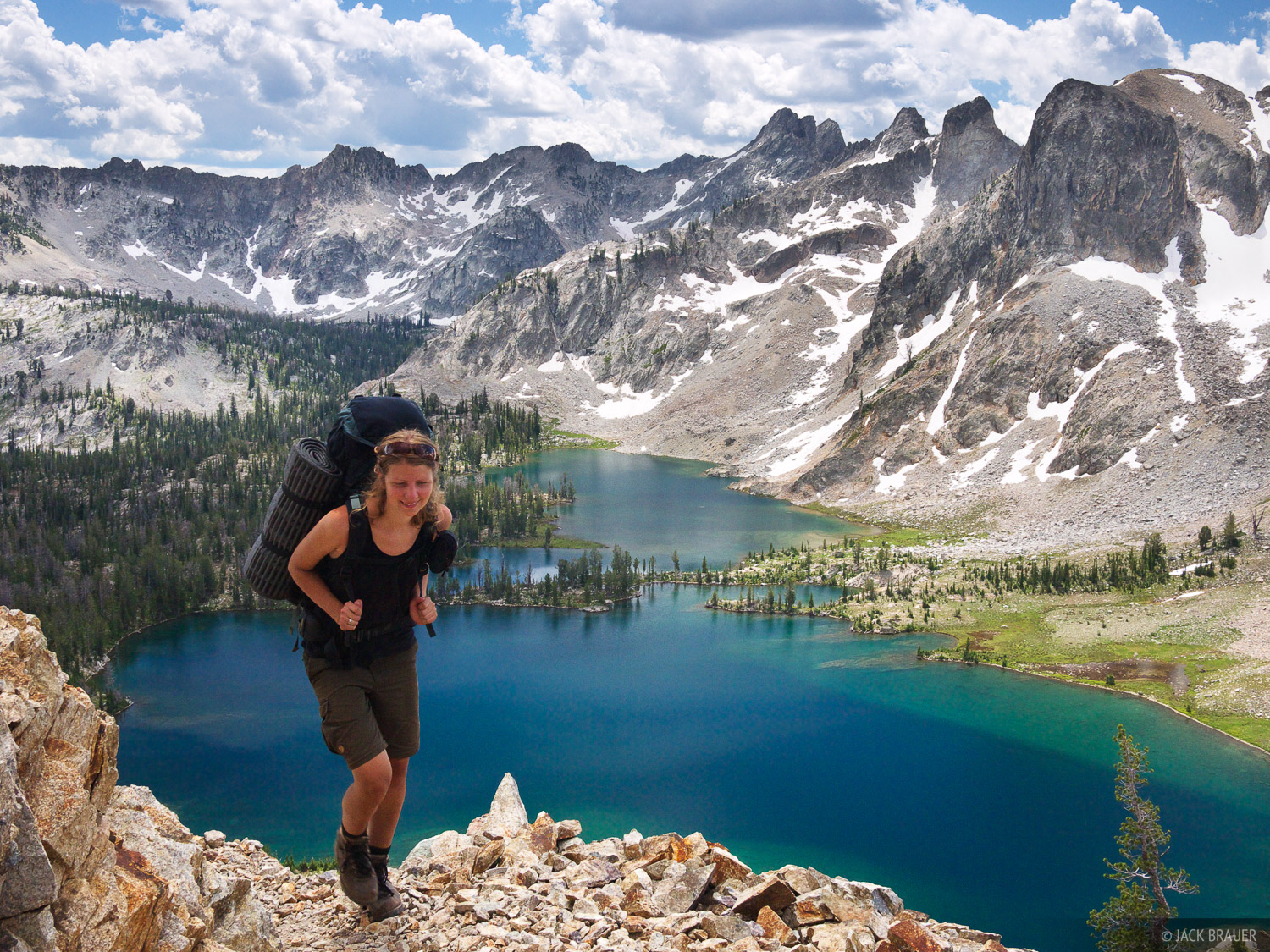 "Hiking above the brilliant blue Twin Lakes.  This scene is a ""typical"" view in the Sawtooth Mountains, with their rugged..."