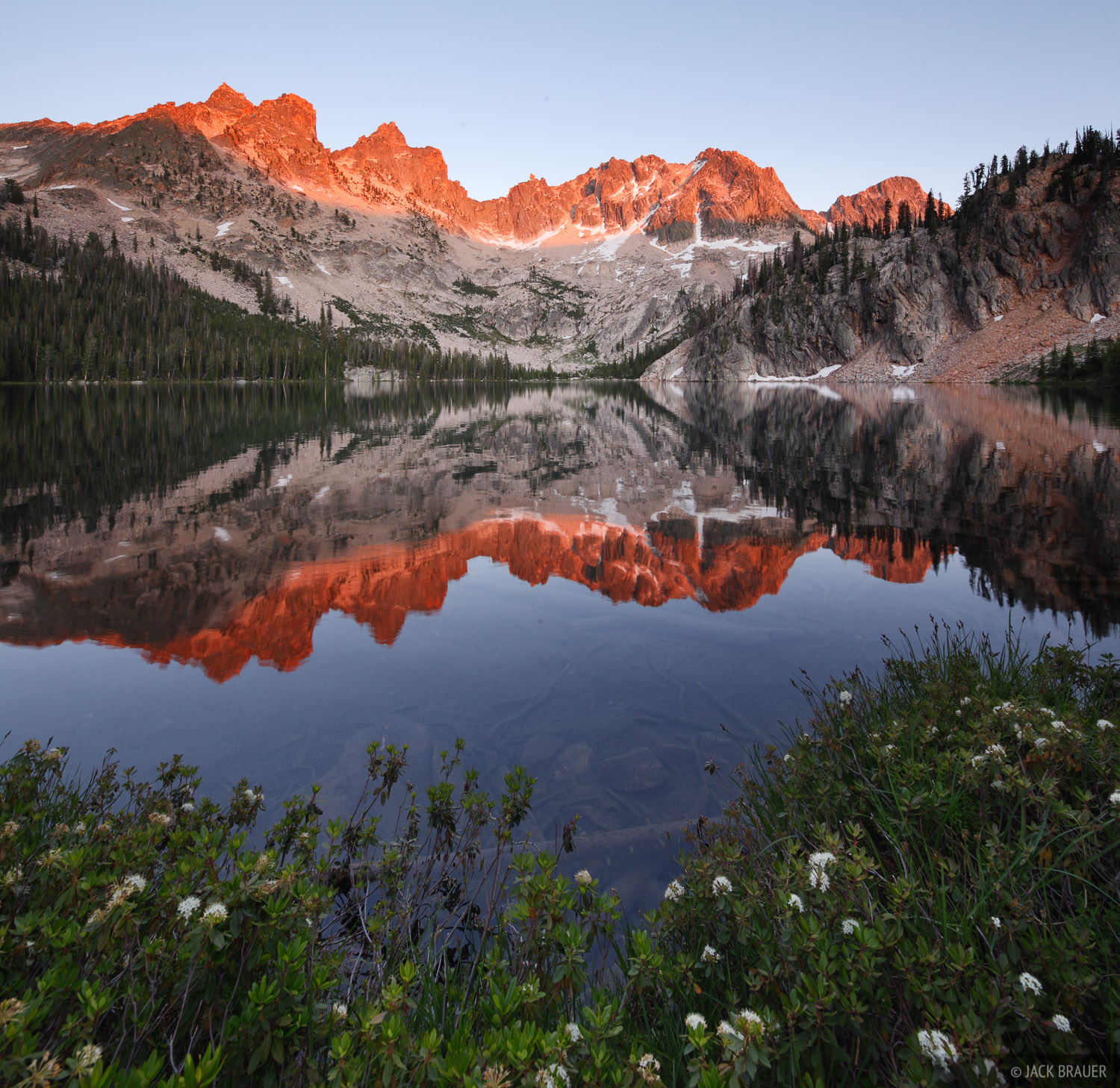 Sevy Peak reflects in Upper Cramer Lake at sunset on a calm blue sky August evening.