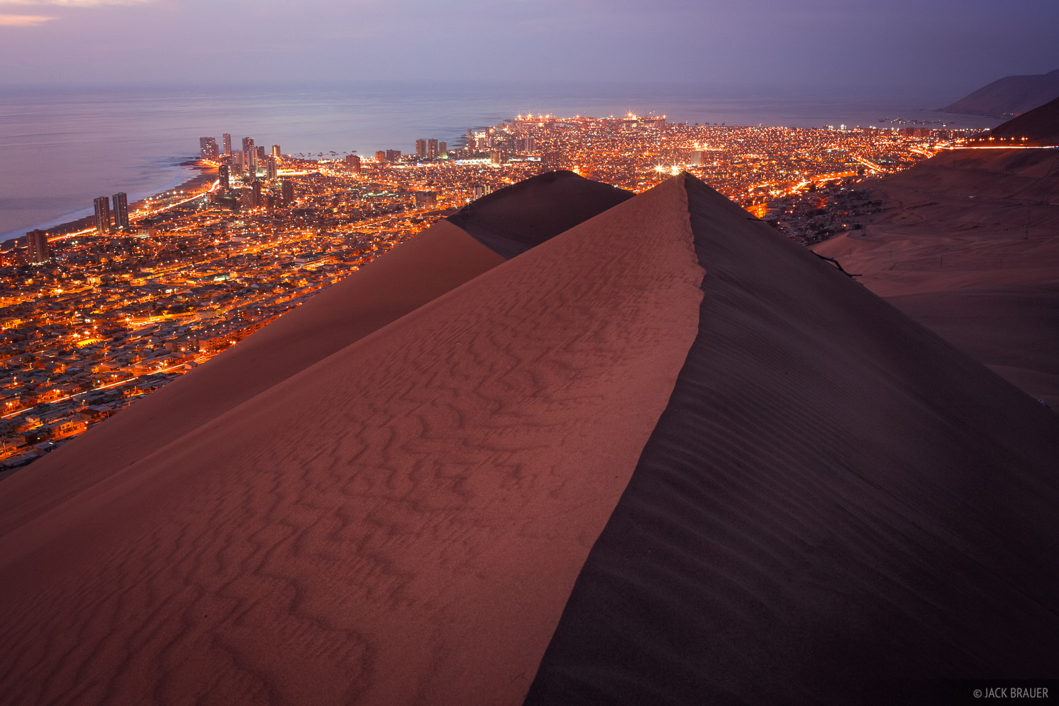 The lights of Iquique shine brilliant as seen from the top of Cerro Dragon, a huge dune that looms over the city.