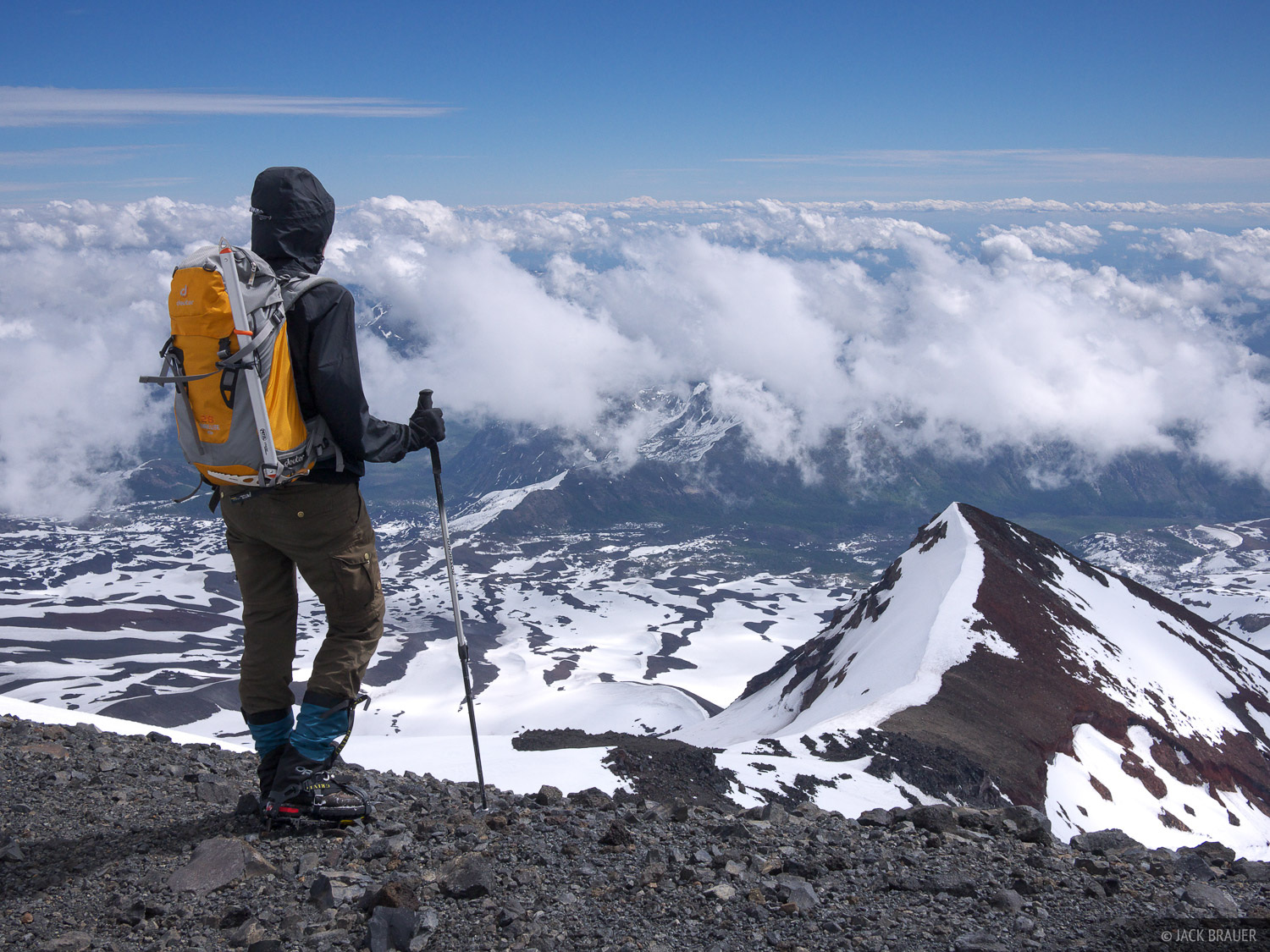 Claudia surveys the views above the clouds from the summit of Volcán Nevado.