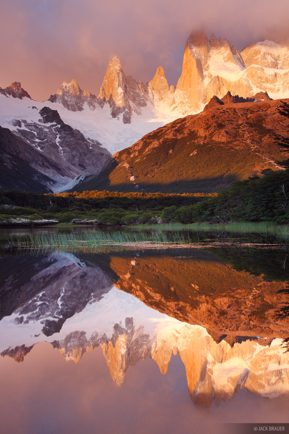 Cerro Poincenot reflects in a small pond at sunrise - December.