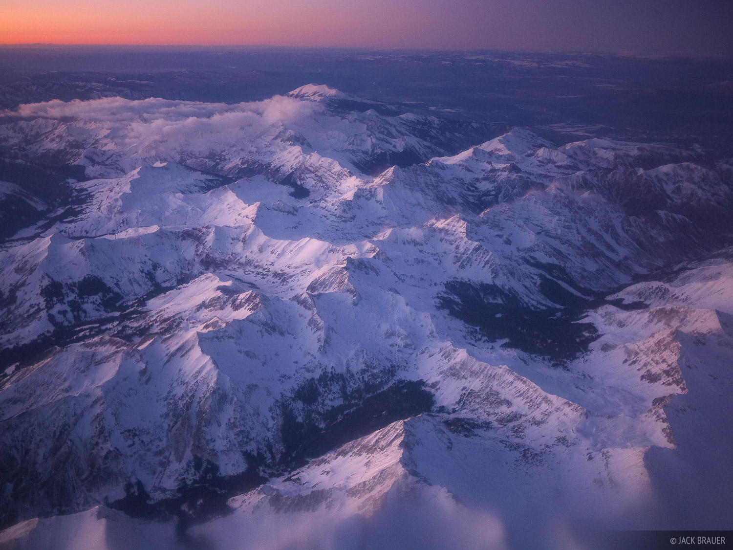 Aerial view of the Elk Mountains near Aspen - January. The Maroon Bells are visible in the upper center of the photo.