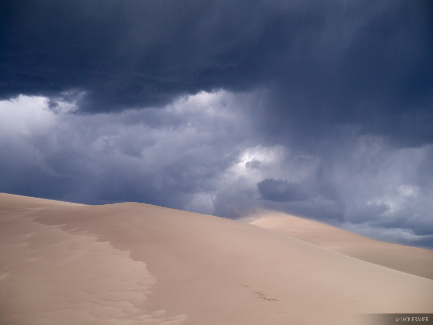 Ominous clouds brew over the Great Sand Dunes, Colorado - June.