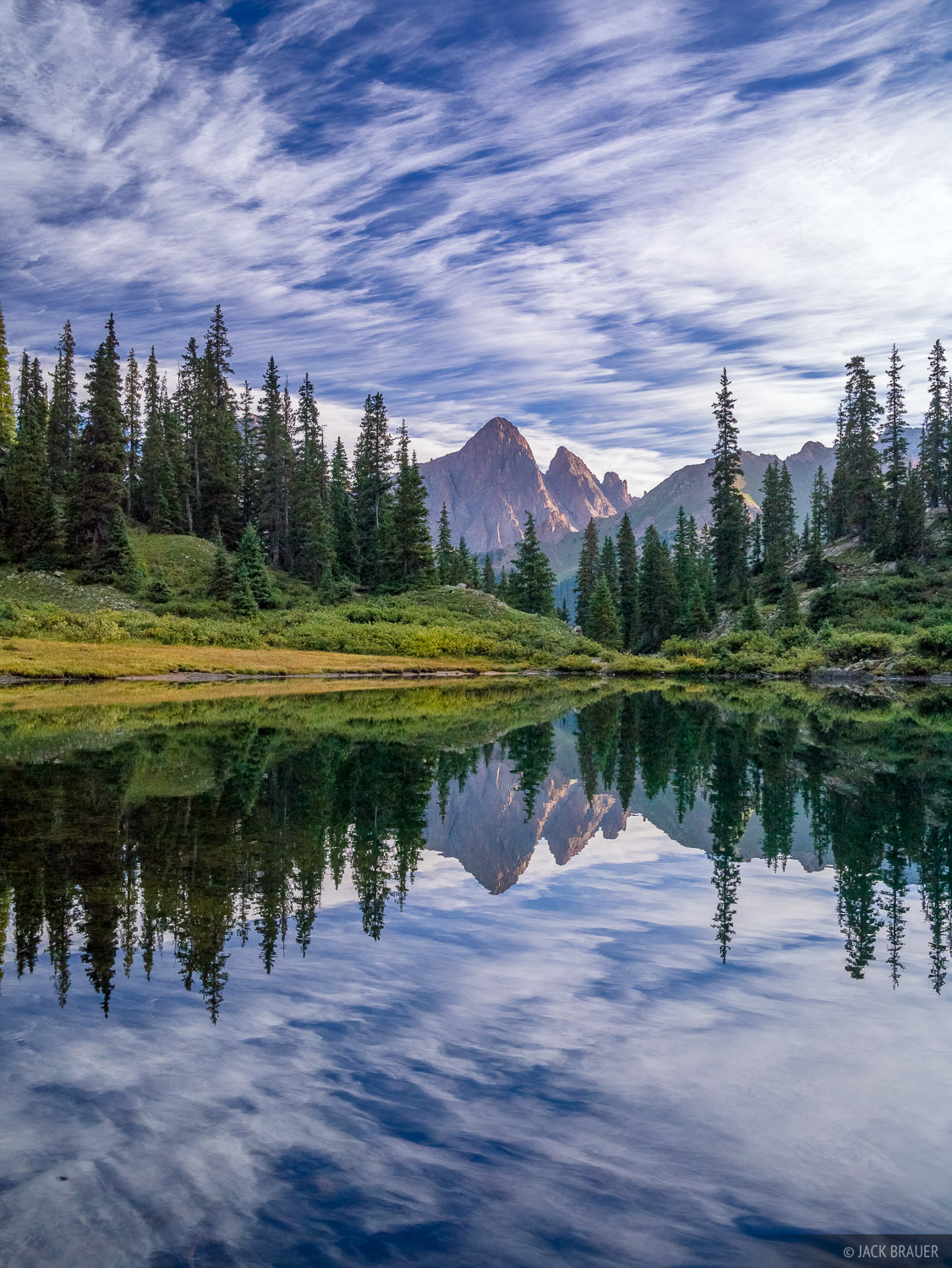 Turret Peak reflects in a remote alpine lake on a gorgeous cloudy September morning.
