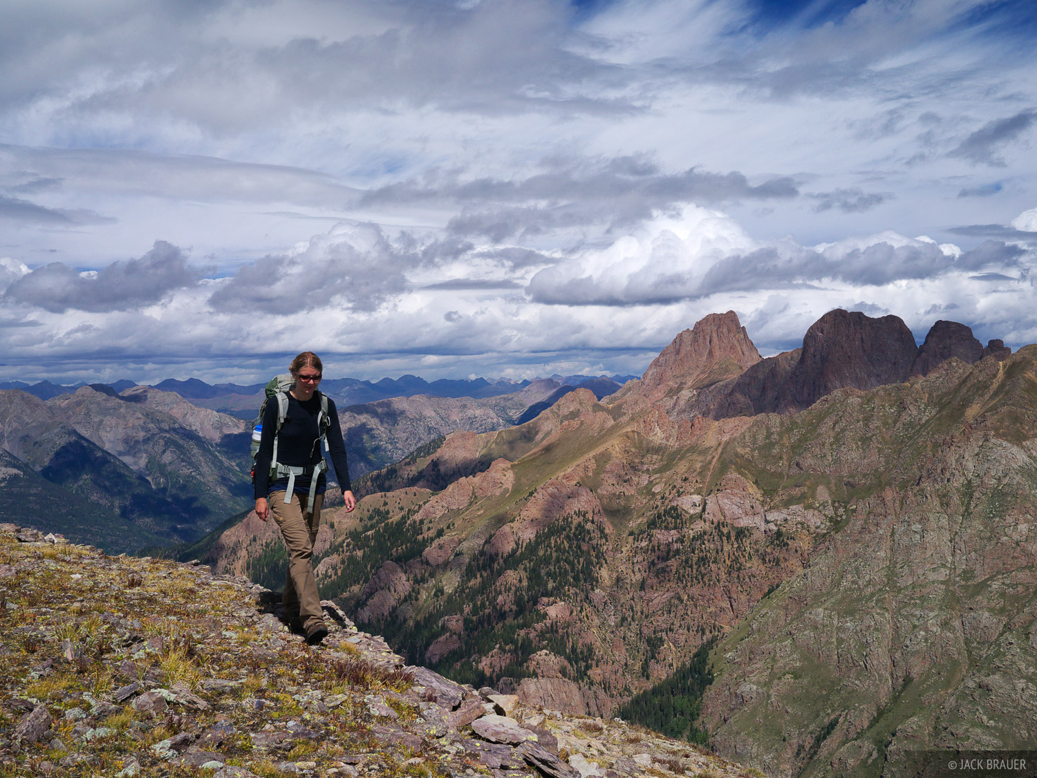 Hiking a high ridge in the Weminuche Wilderness, with Pigeon Peak behind.