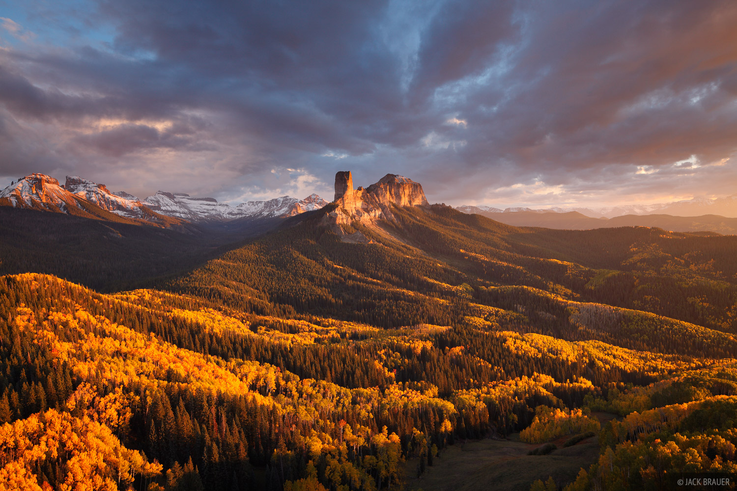 Sunset light on Chimney Rock and Courthouse Mountain in the Cimarron Range near Ridgway, Colorado.