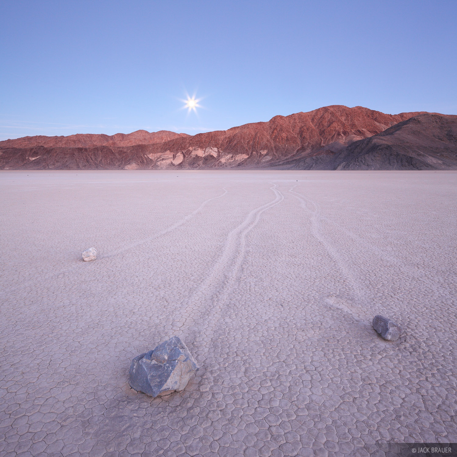 The Racetrack is a mysterious and fascinating location in Death Valley National Park - a flat dry lakebed playa in a remote desert...