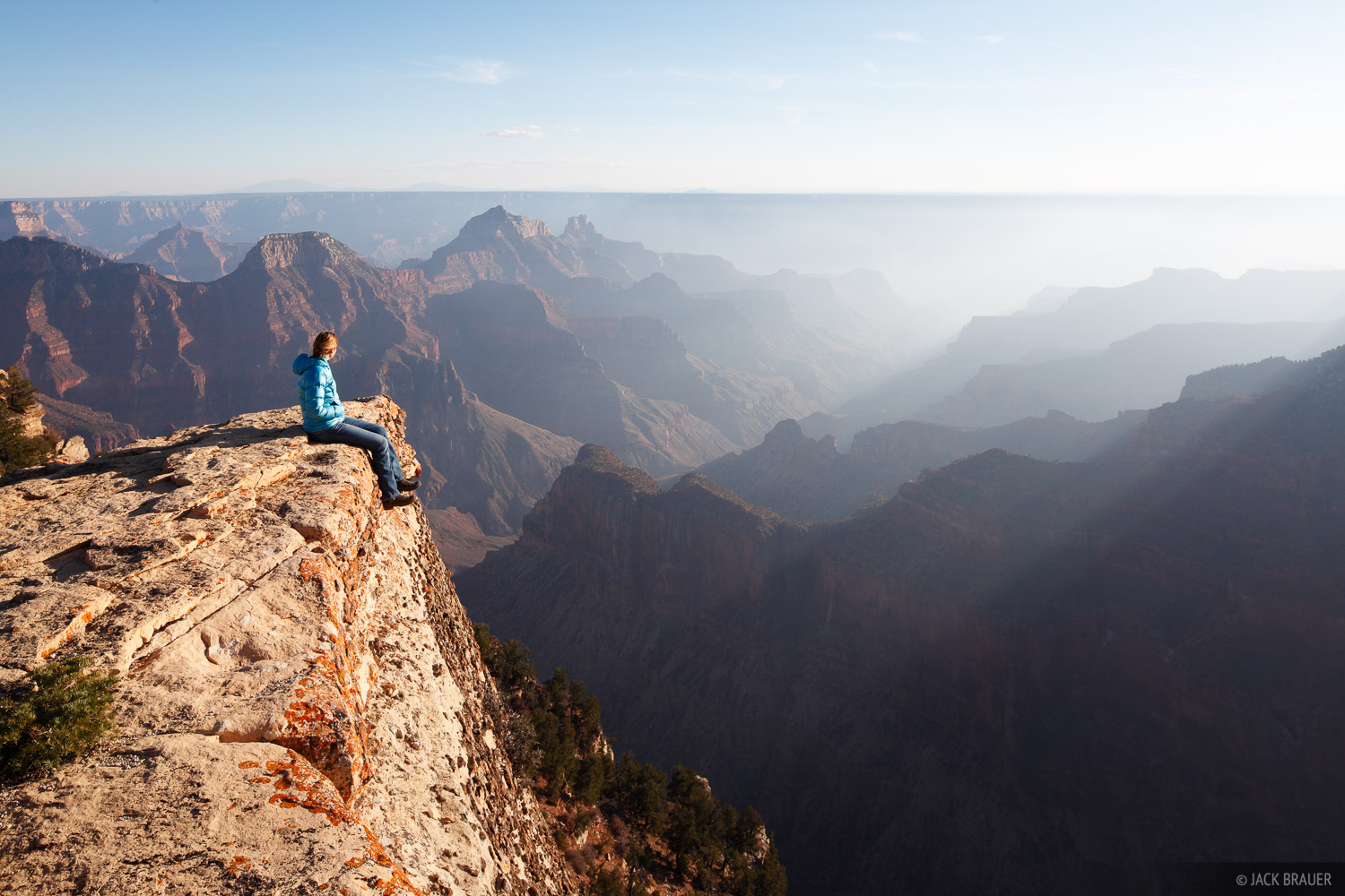 Sitting on the edge of the Grand Canyon, near the Bright Angel Trail.