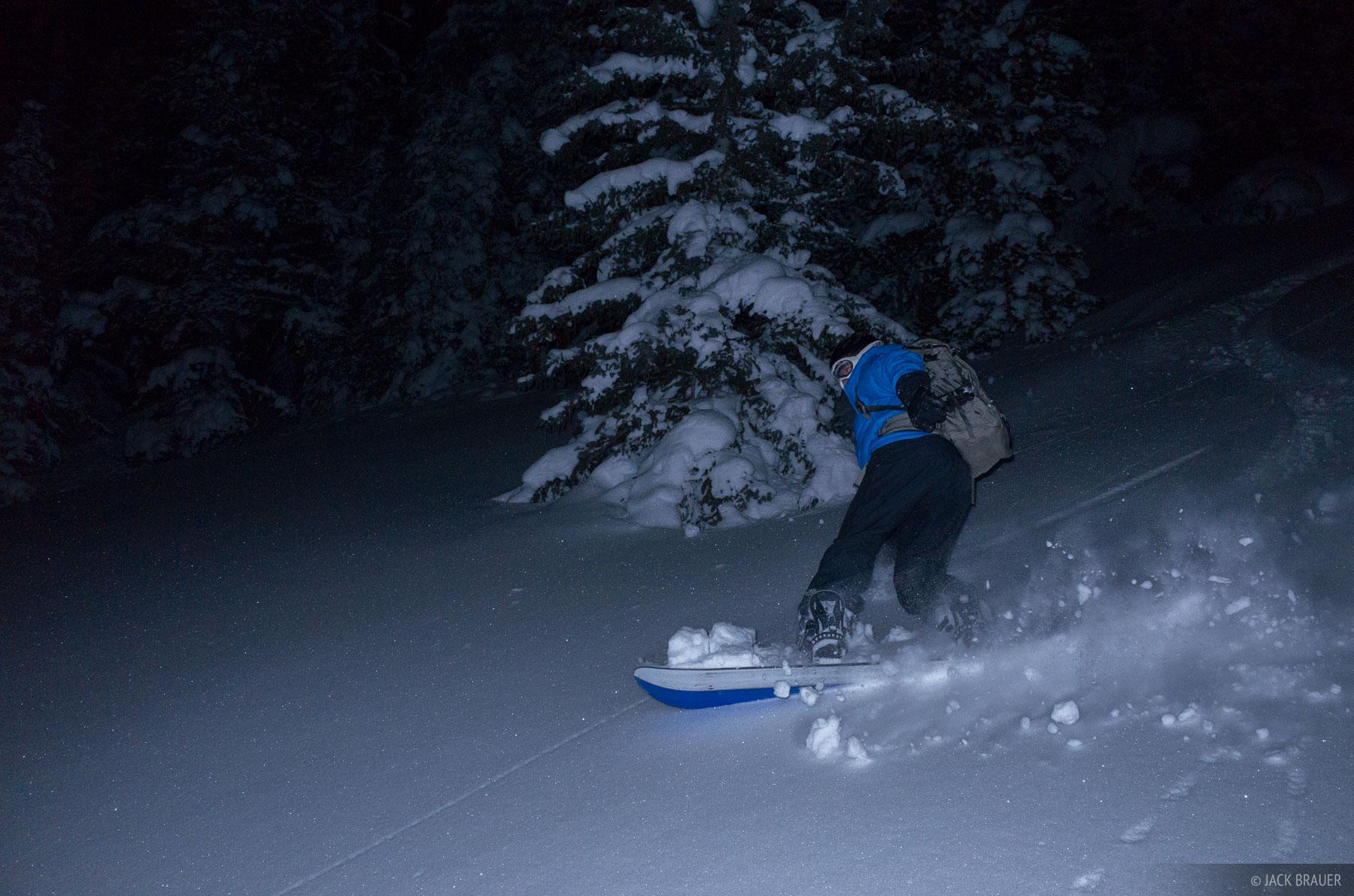 Snowboarding powder under a full moon - January.