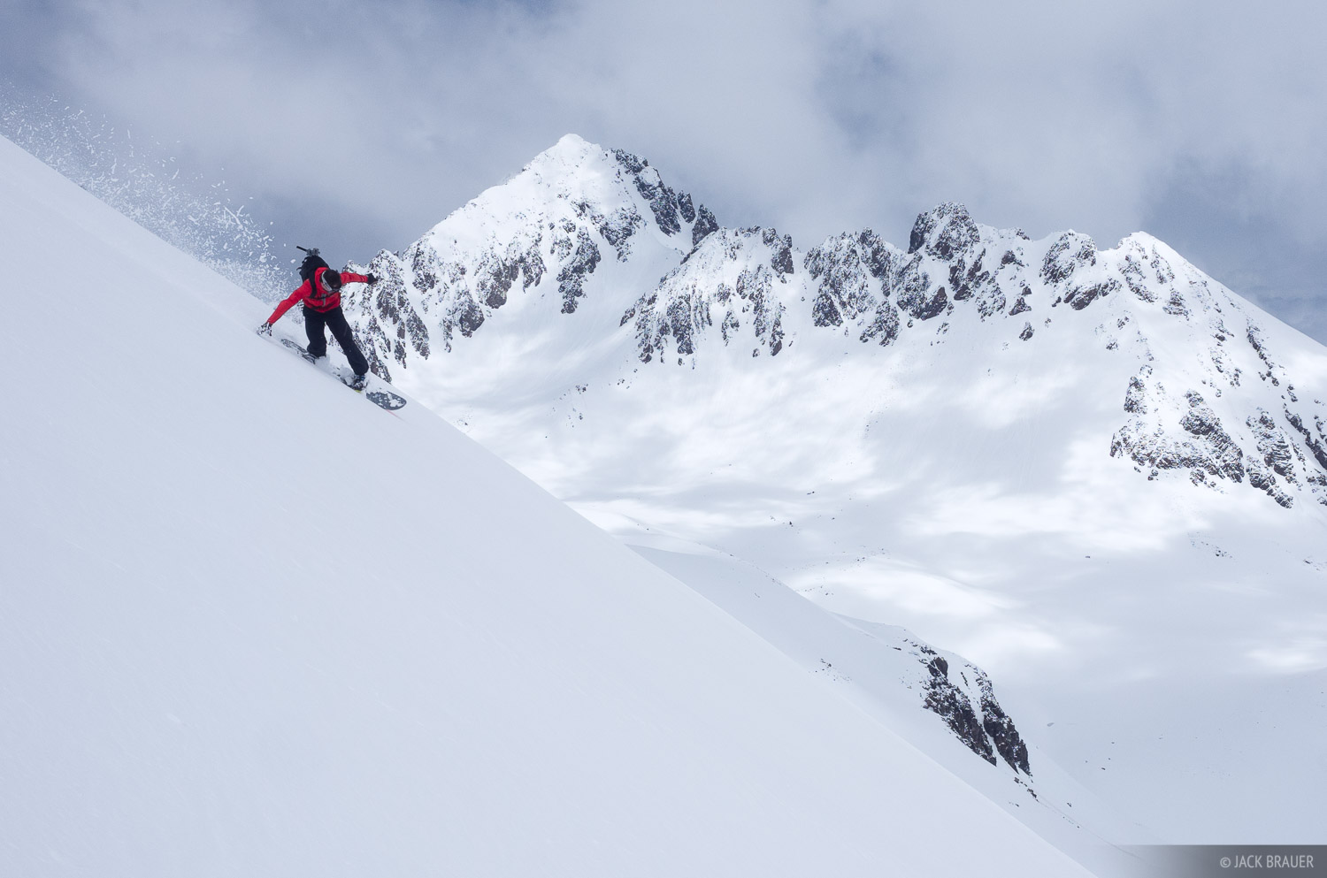 Snowboarder: Mikel Goicoechea. Mt. Sneffels in the background. May.