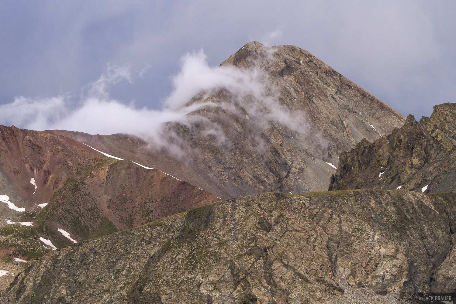 Clouds stream over Mt. Lindsey (14,047 ft.)