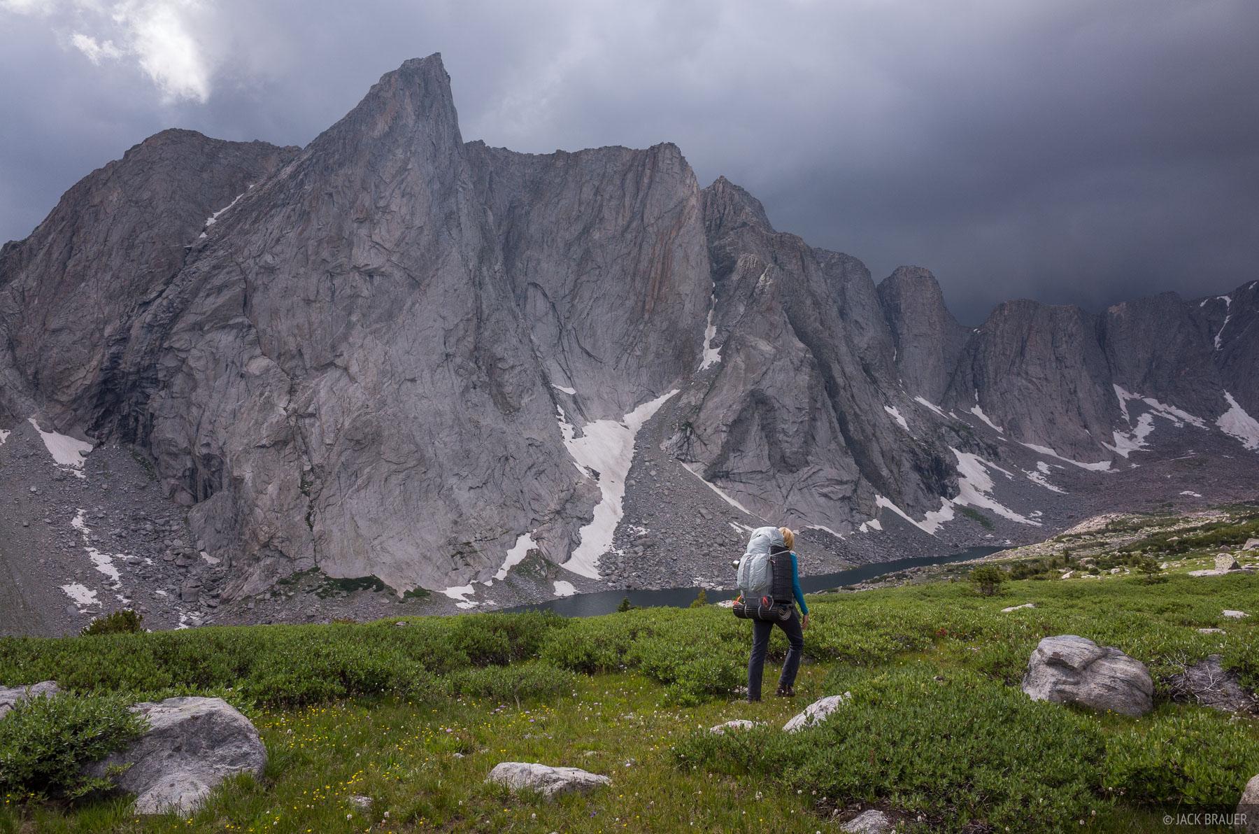 Hiking towards Ambush Peak as an ominous thunderstorm brews above.