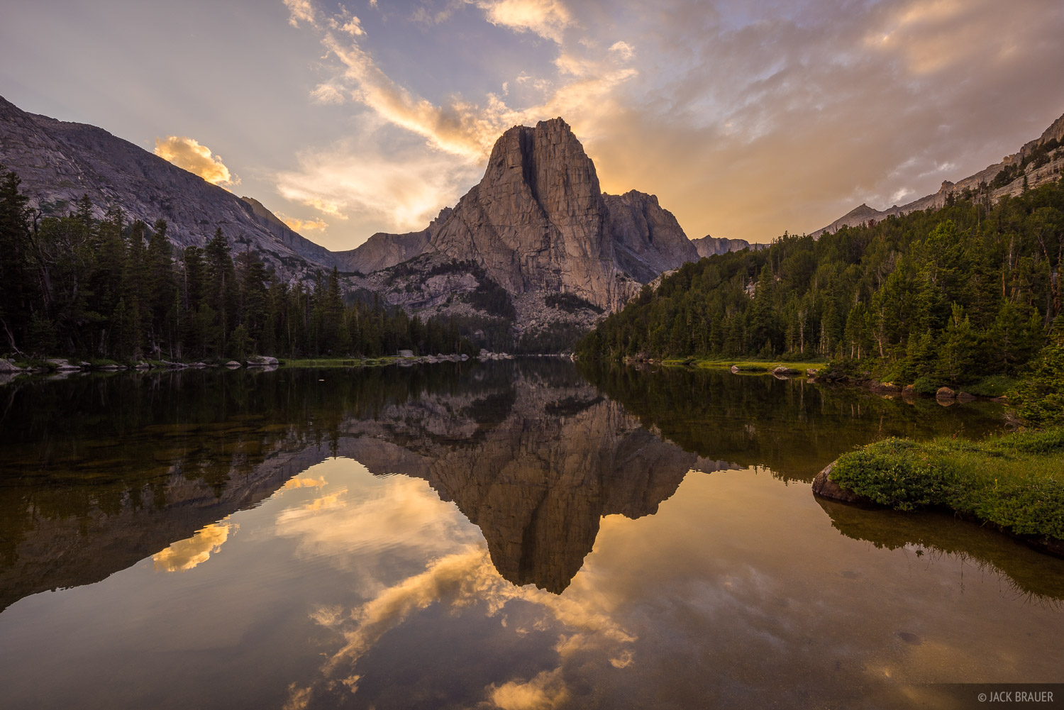 Cathedral Peak (or technically an arm of Cathedral Peak) reflects in Cathedral Lake at sunset.