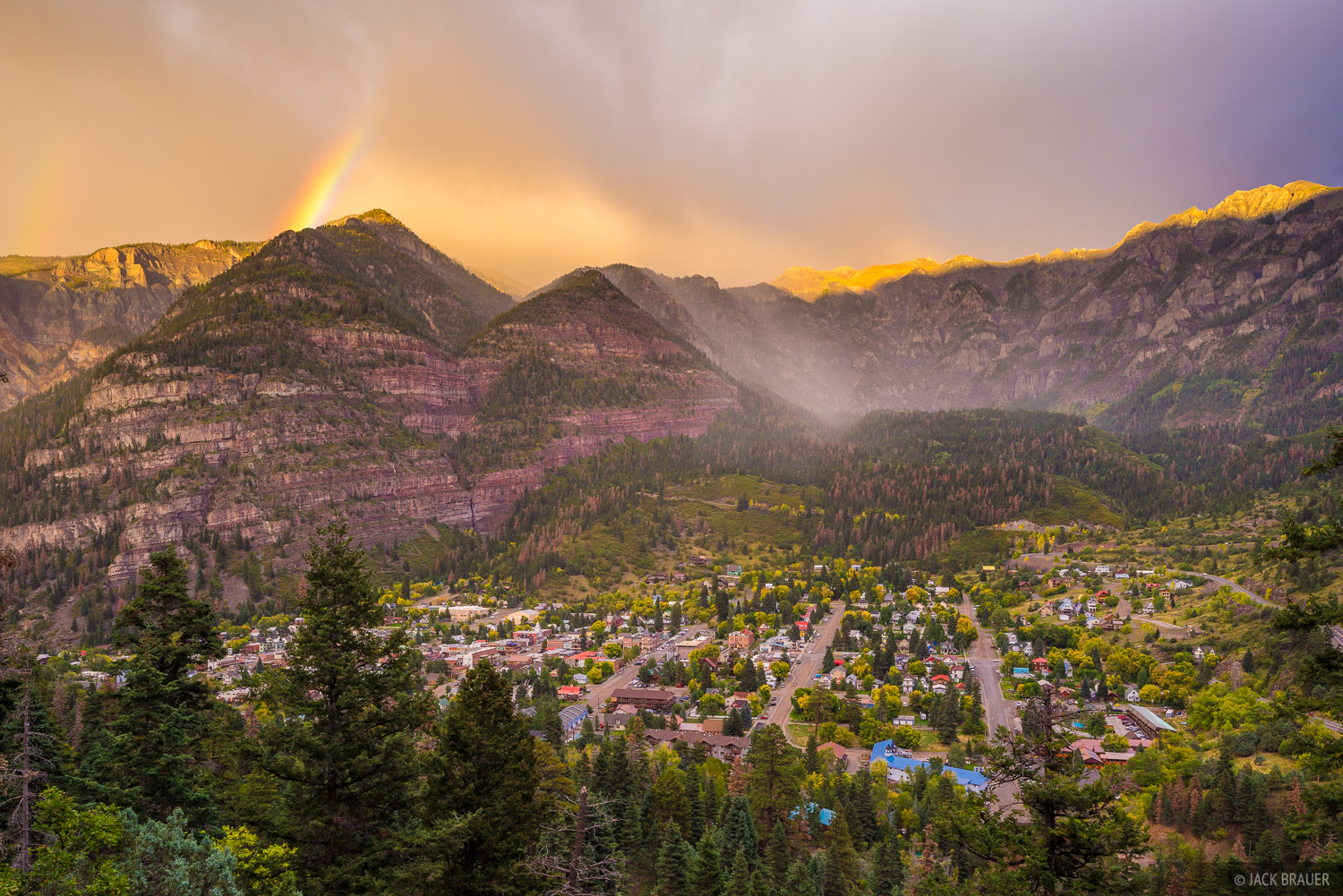 A sunset rainbow over the town of Ouray - San Juan Mountains, Colorado.
