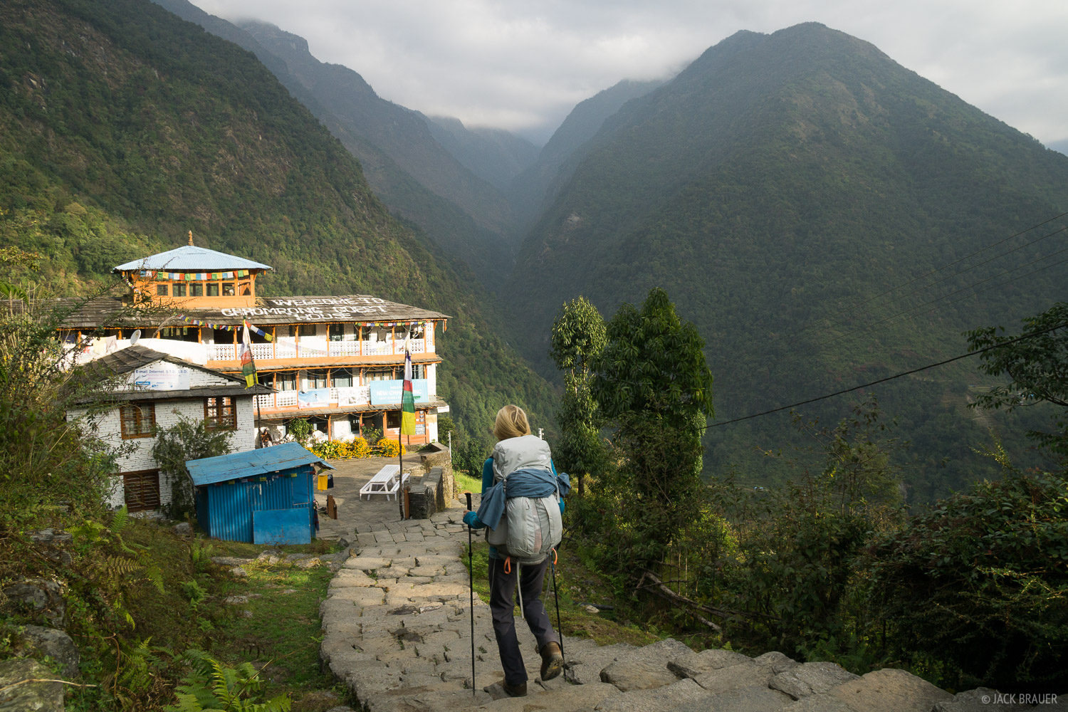 Hiking through the village of Chomrong in the morning.