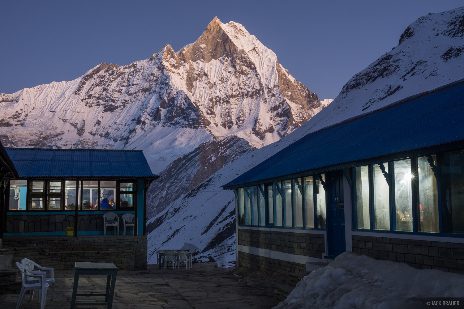Machhapuchhre towering over Annapurna Base Camp, at twilight.