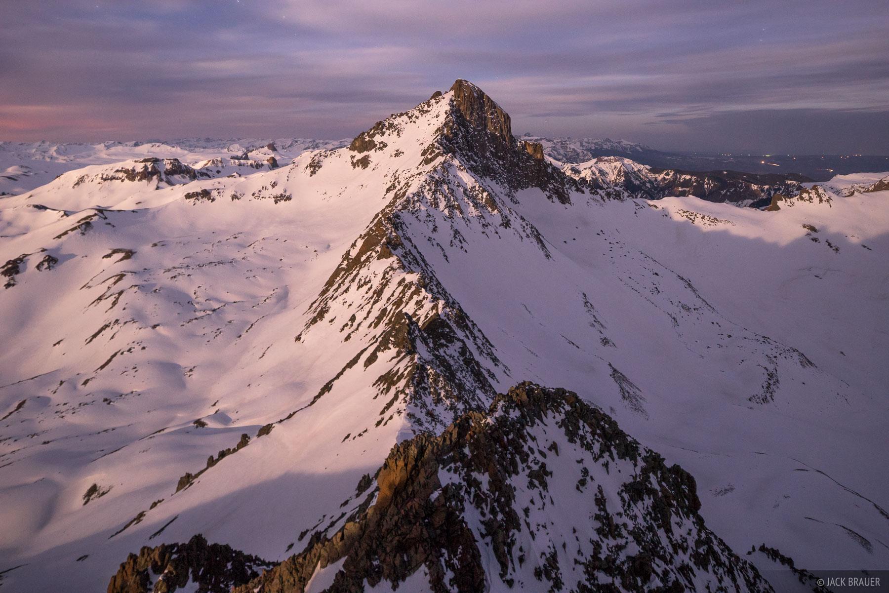 Moonrise light illuminates Wetterhorn Peak - April.
