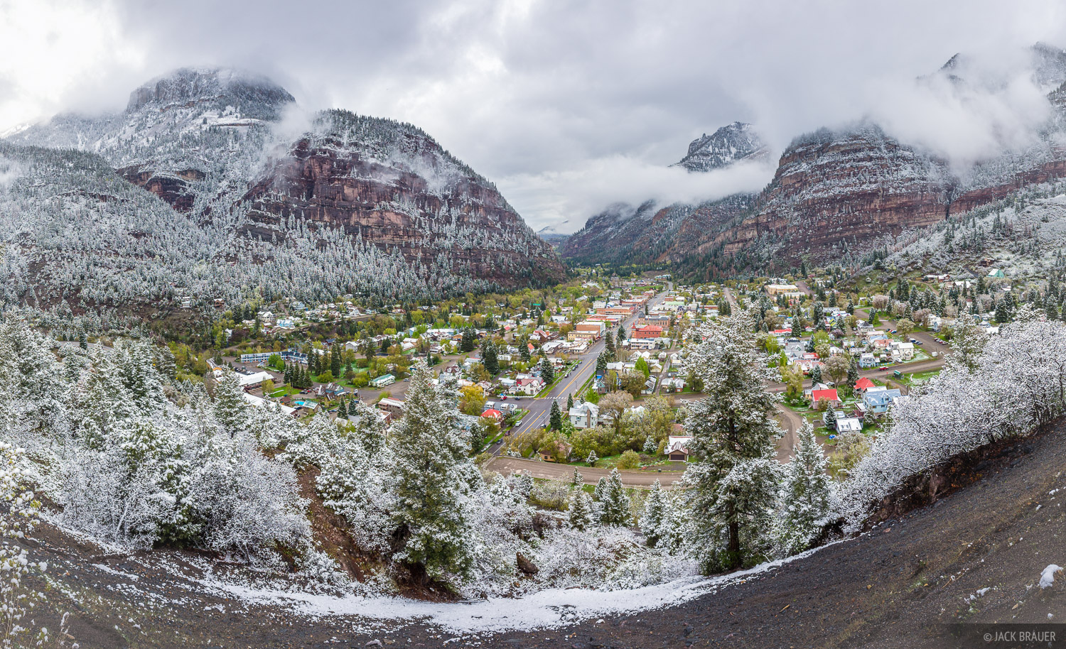 As trees bloom green in the town of Ouray, a May snowstorm cakes the surrounding mountains in powder.