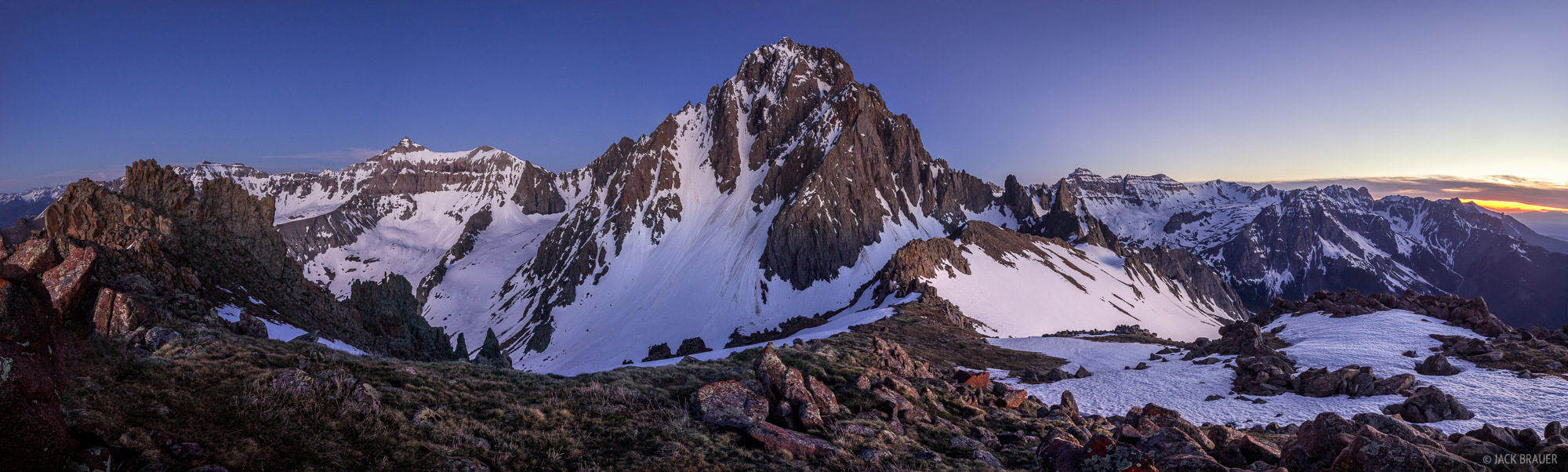 Mount Sneffels (14,150 ft.) towering over its surroundings at dusk in early June.