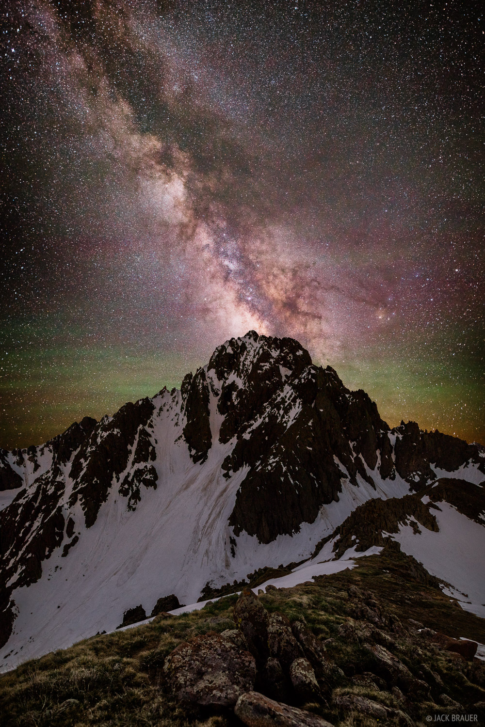Mt. Sneffels in the Milky Way on a new moon night in June.  The green color behind Sneffels is airglow, a common phenomenon...