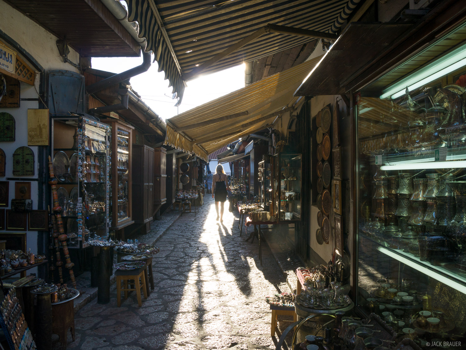 Strolling through a narrow alley of shops in the old town of Sarajevo.