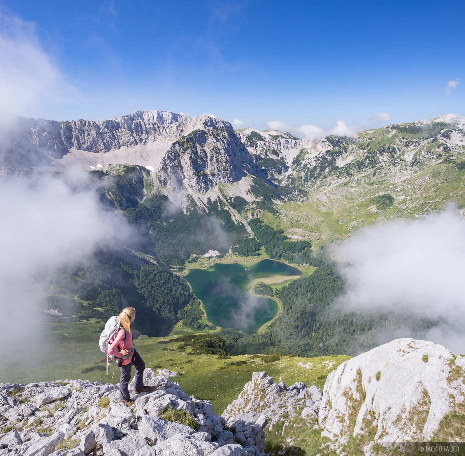 A hiker enjoys the view above Trnovacko Jezero, in Montenegro not far from the border of Bosnia.