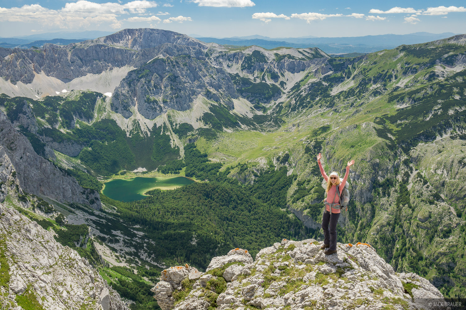Celebrating the views high above Trnovacko Lake near the border of Bosnia and Montenegro.