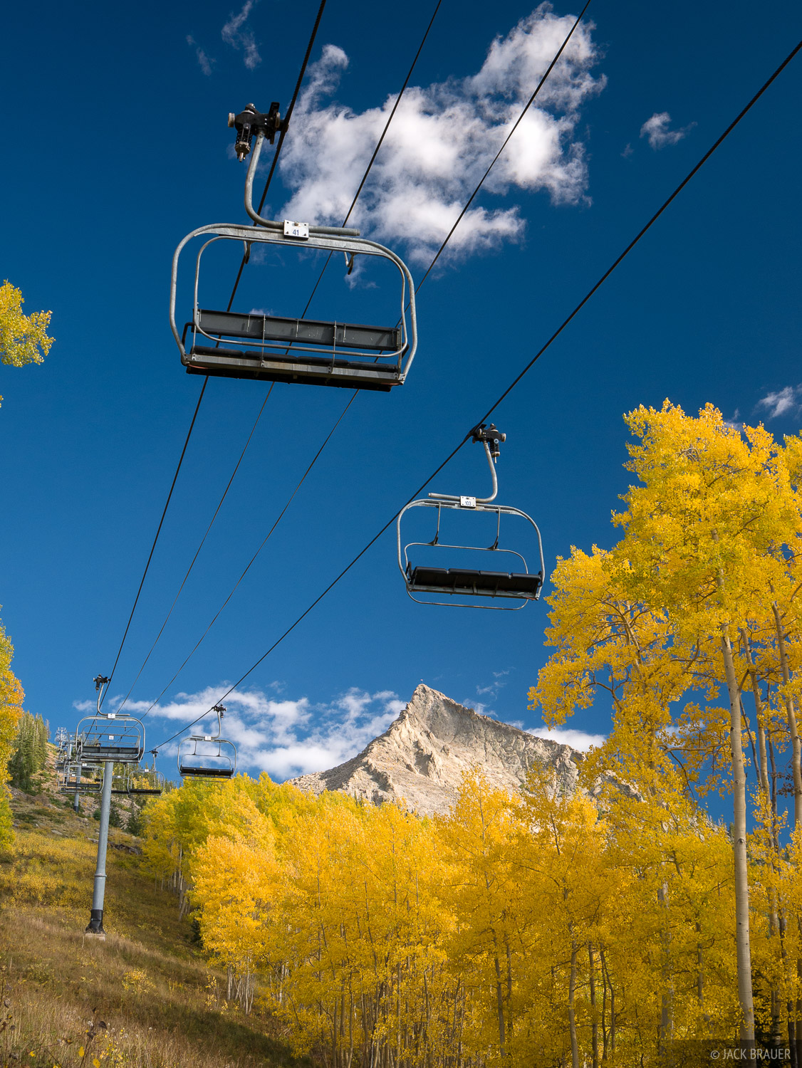 Chairlifts and golden aspens on Mt. Crested Butte - September.