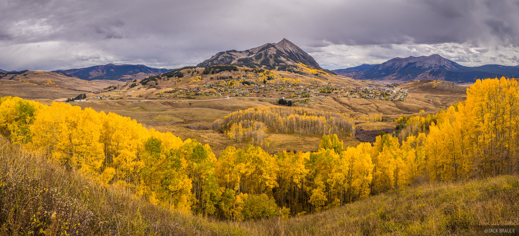 Mt. Crested Butte and golden autumn aspens on a cloudy September day.