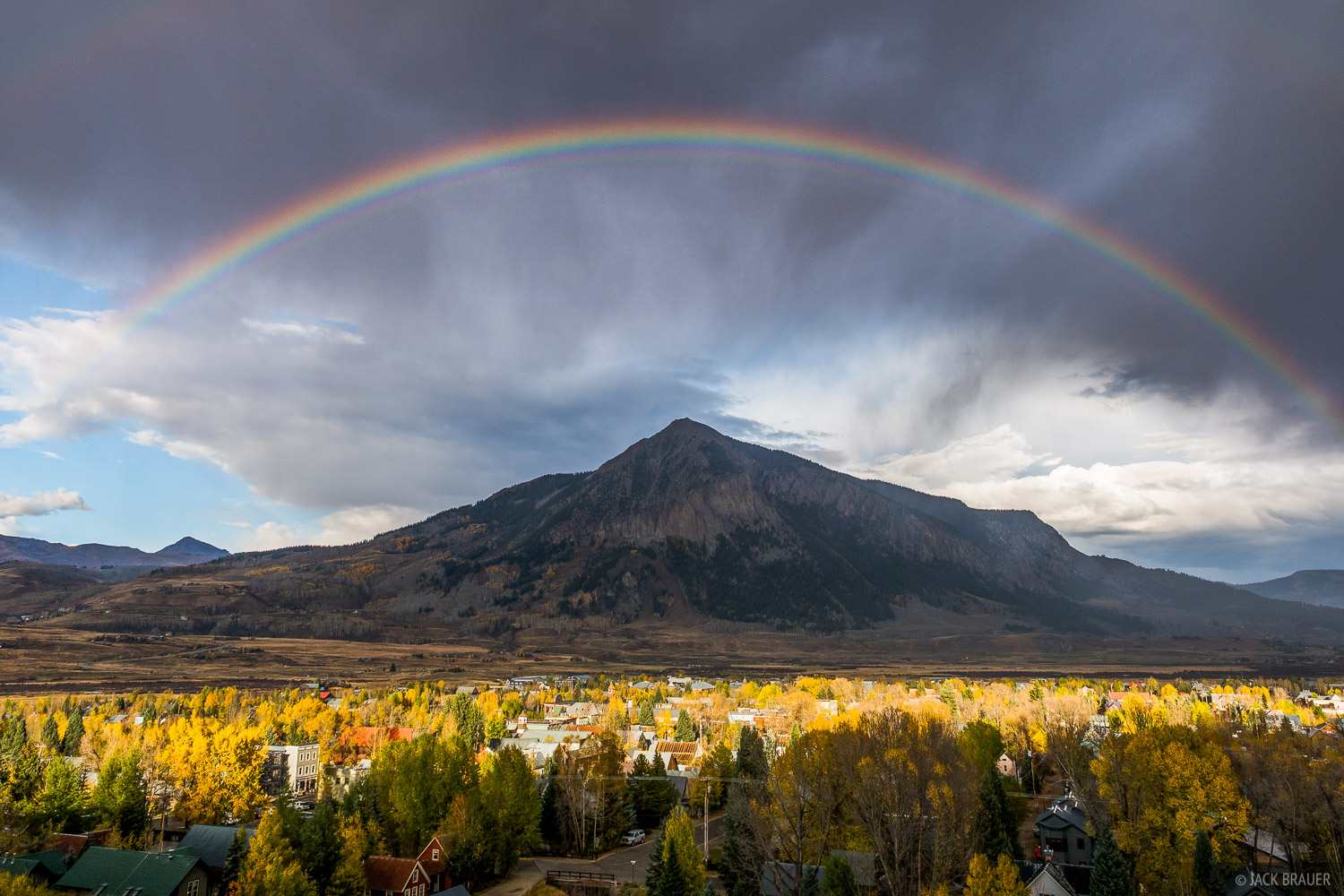 A rainbow shines over the town of Crested Butte, Colorado - October.