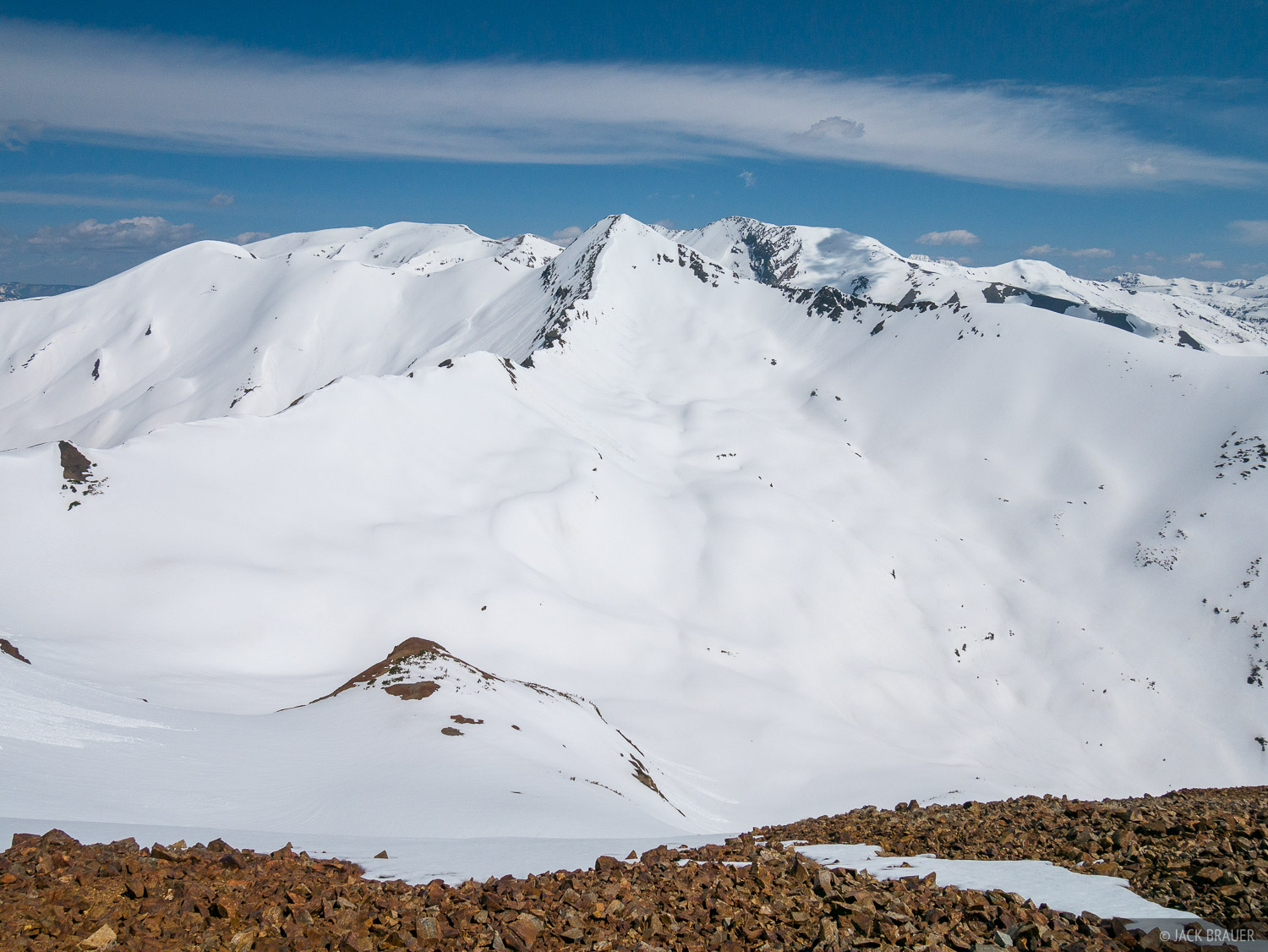 The snow smothered south face of Purple Mountain (12,958 ft.) in late May.