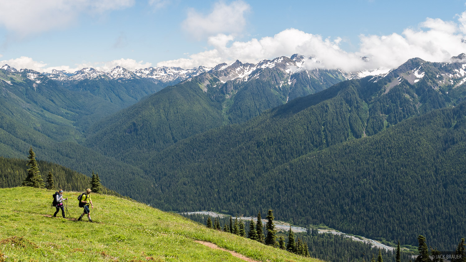 Hikers on the High Divide trail with the Hoh River valley below.