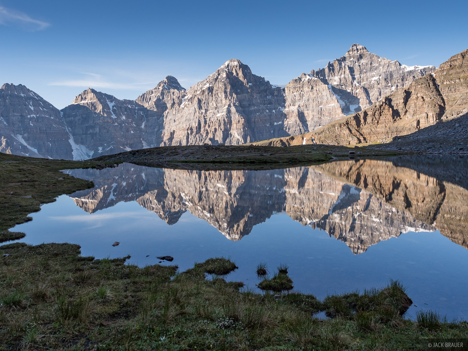 The Valley of the Ten Peaks reflecting in a tarn.