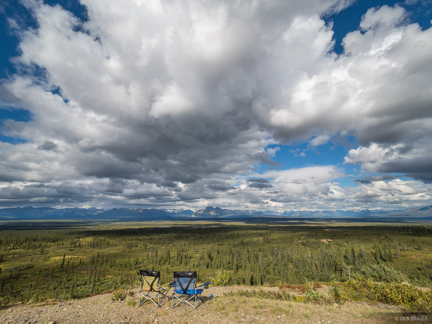 Driving along the remote and potholed Denali Highway, we spent an evening at this random camp spot overlooking the vast Monahan...