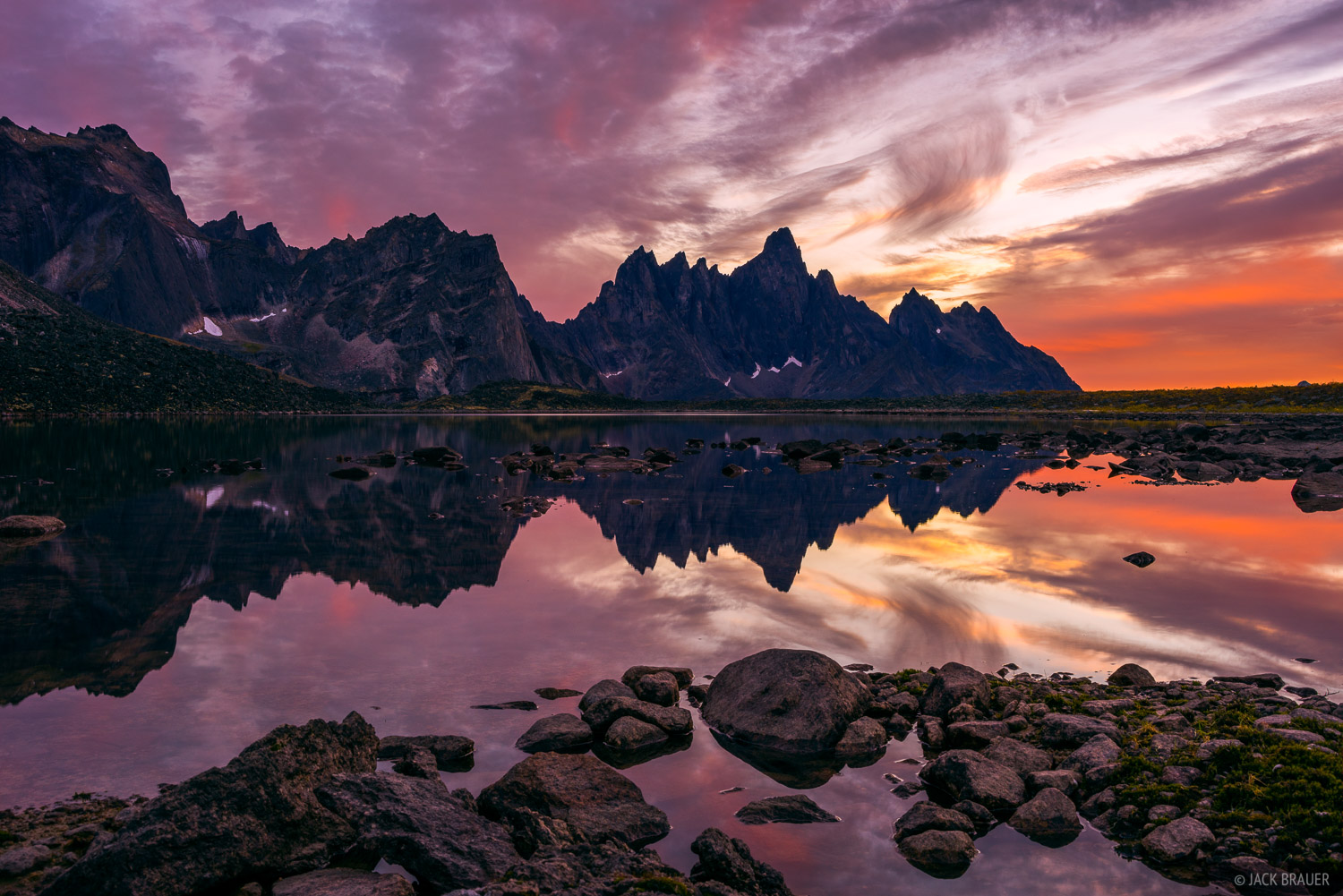 """Tombstone Mountain reflects in Talus Lake during a fiery sunset. This was actually a """"second"""" sunset; the sun had already set..."""