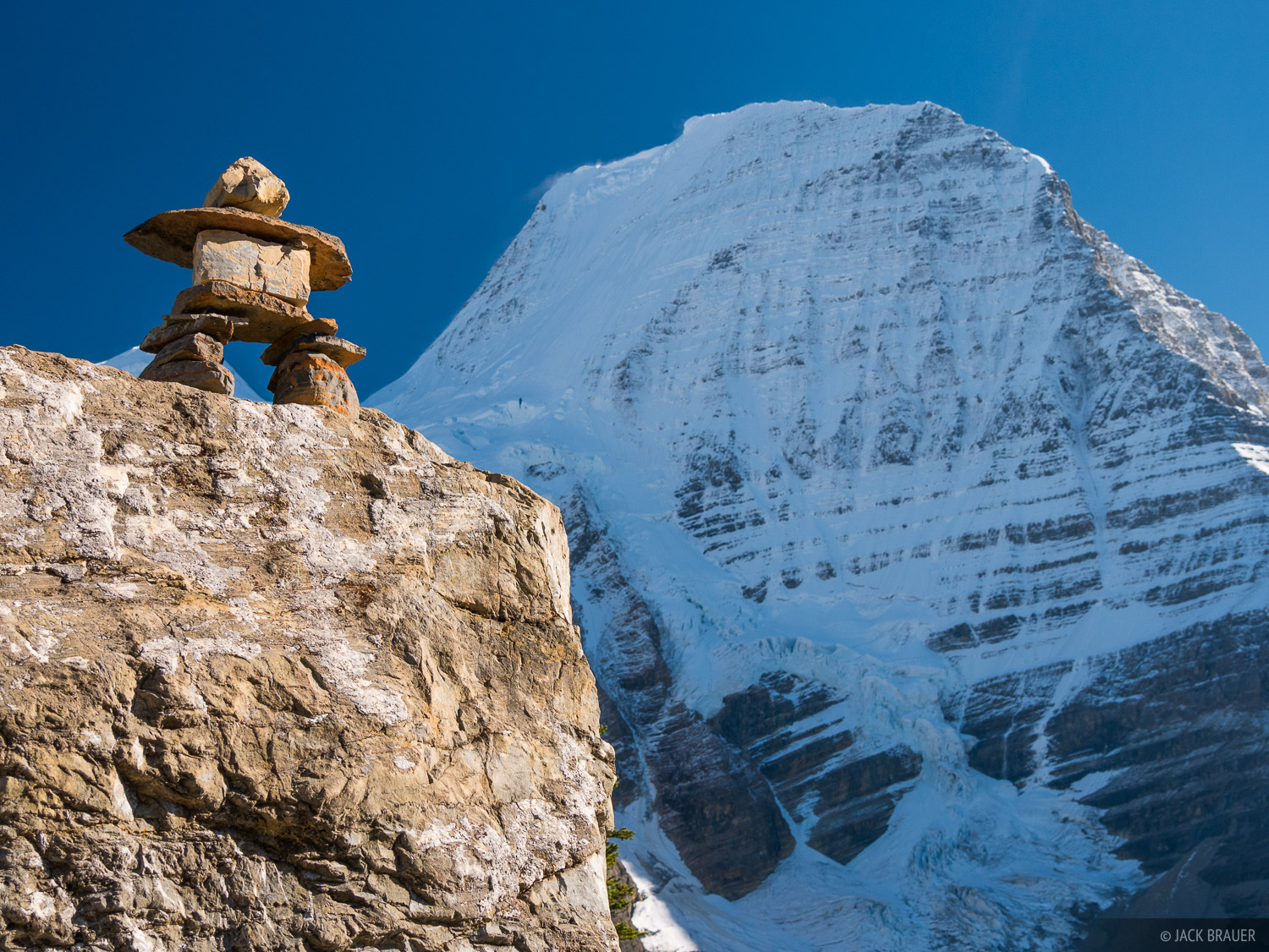 A cairn along the trail to Hargreaves Glacier, with Mount Robson looming overhead.