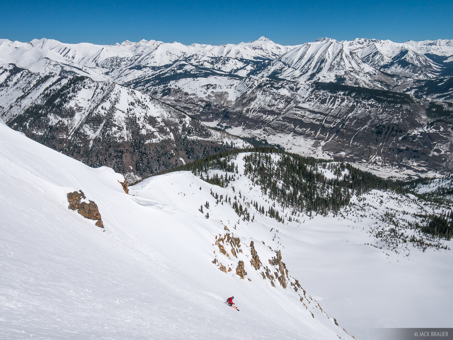 Paul DiG skis down the steep east face of Mount Emmons into Wolverine Bowl, Crested Butte, Colorado - May.