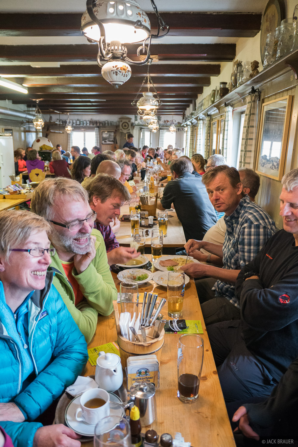 A typical scene inside an Alpine hut at dinnertime, with lots of beer and laughter!
