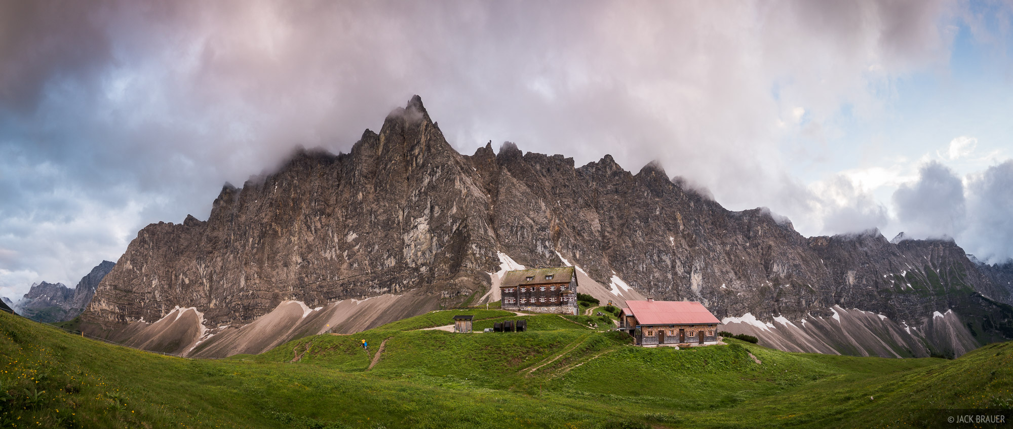 A panoramic view of Laliderer Spitze and the Karwendel mountains above the Falkenhütte at sunset.