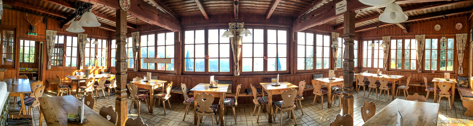 The gorgeous dining room of the Vorderkaiserfeldenhütte, surrounded by windows with amazing views of the valley and mountains...