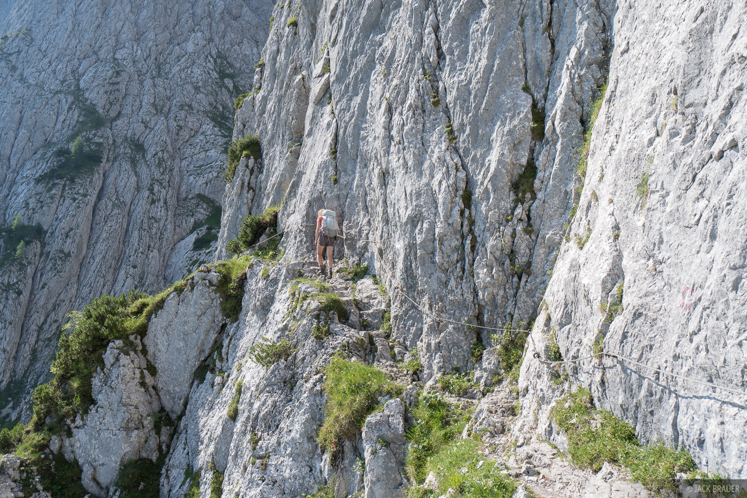 Hiking along a precipitous ledge at the beginning of the famous Eggersteig route.