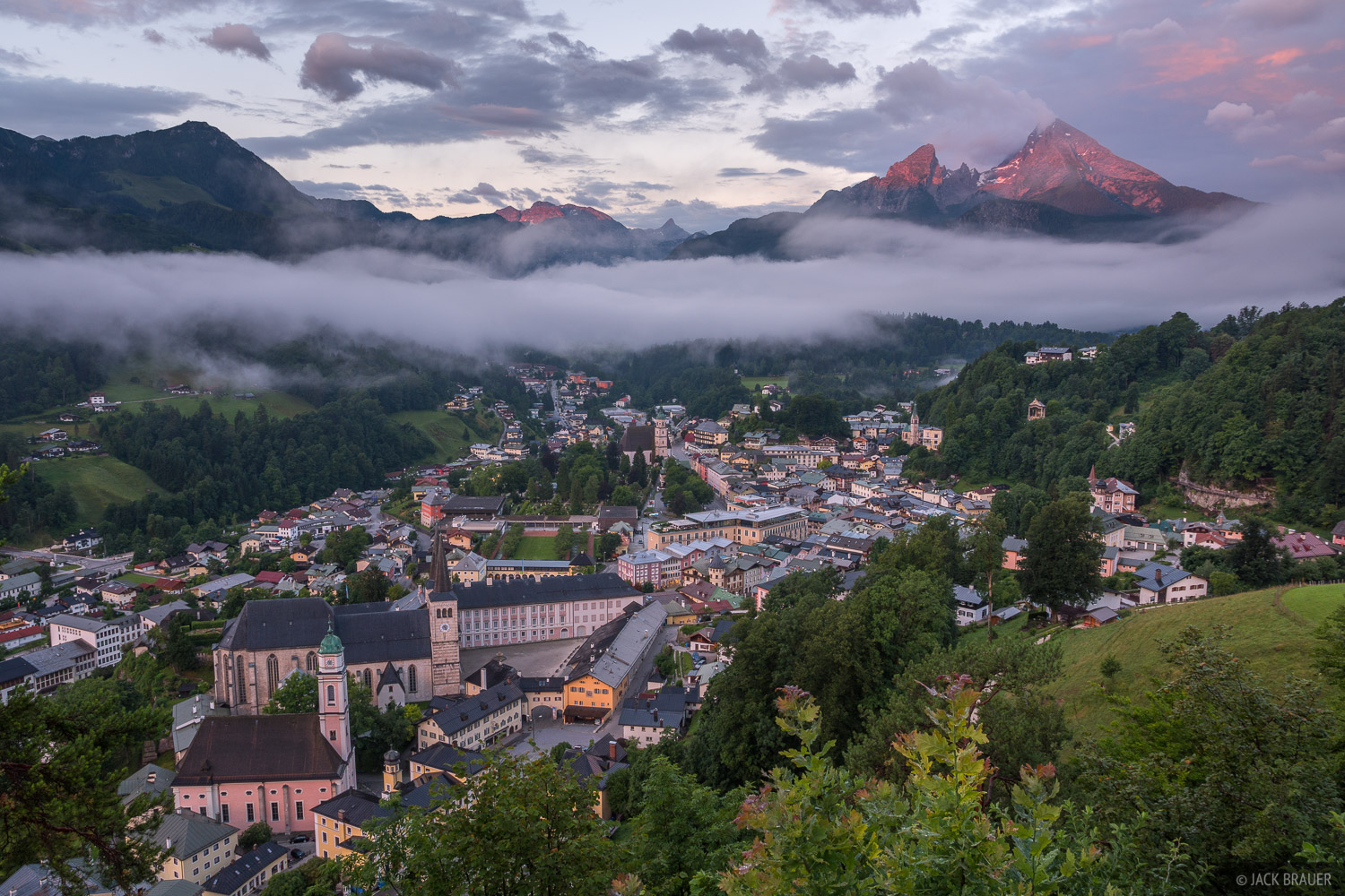 As rainy weather clears off, sunrise light illuminates Watzmann over the town of Berchtesgaden.