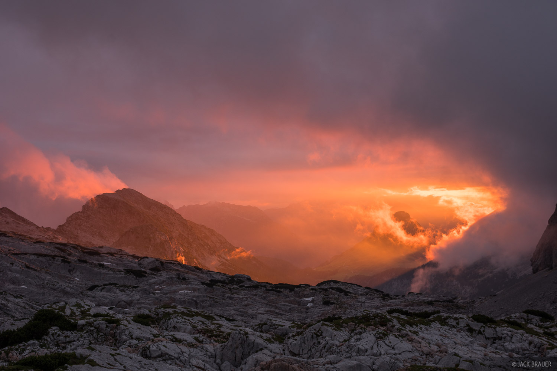 Spectacular sunset light beams through a gap in the clouds, as seen from near the Ingolstädterhütte.
