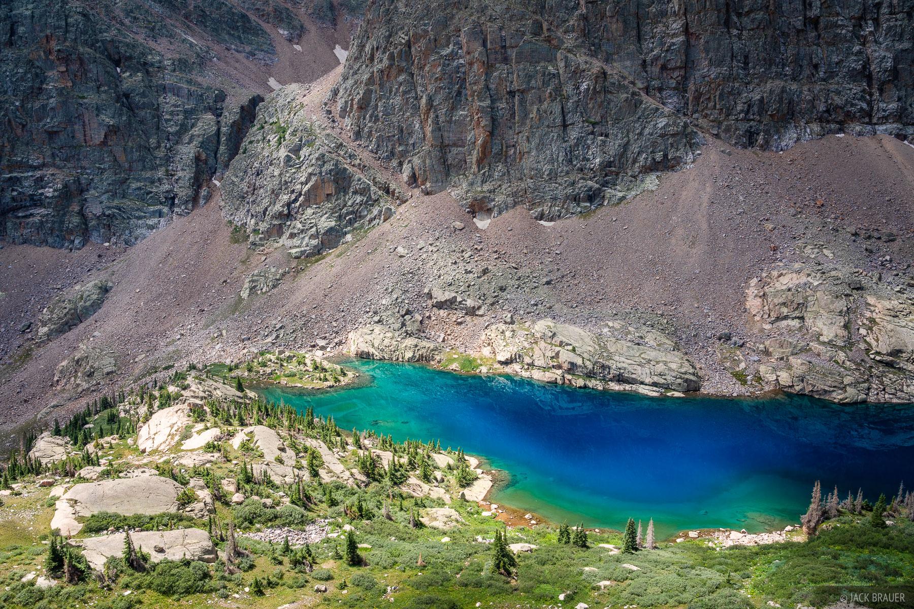 Brilliant aqua blue colors in a very remote alpine lake in the Weminuche Wilderness.