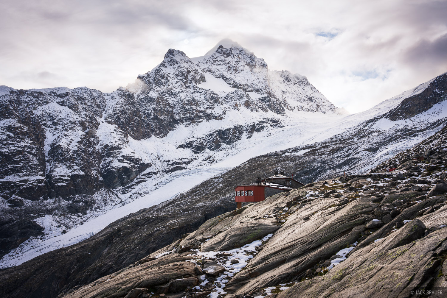 The Coaz hut with a backdrop of glaciers and rugged peaks.
