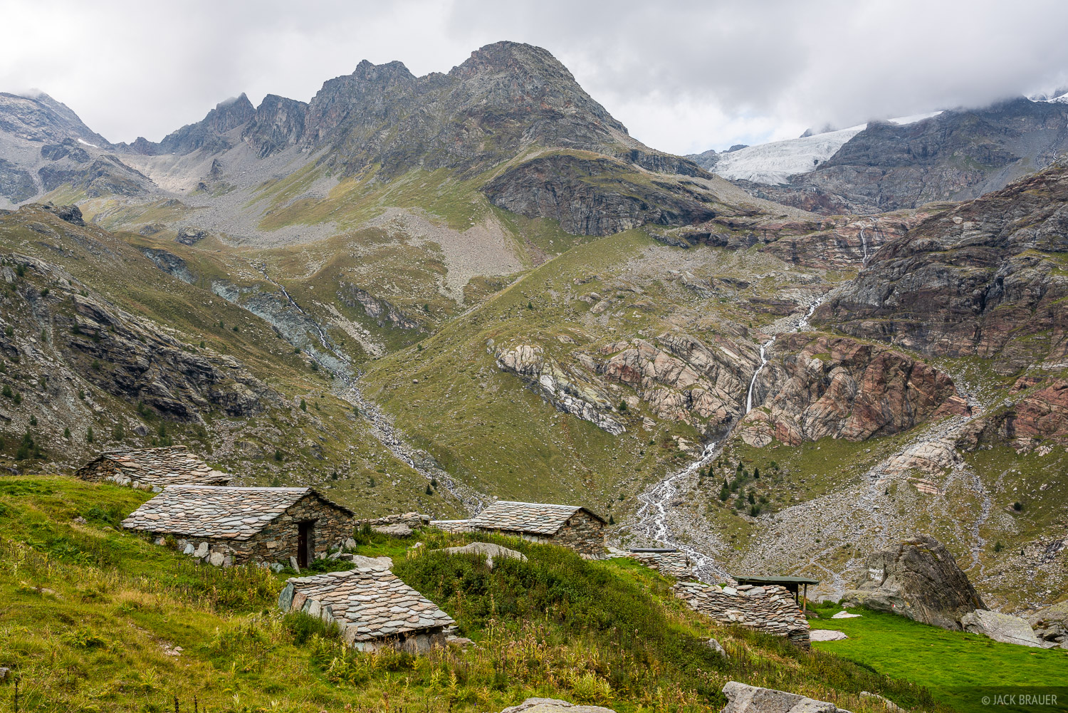Traditional stone houses of sheep and goat herders at Alpe Gembré in Italy.