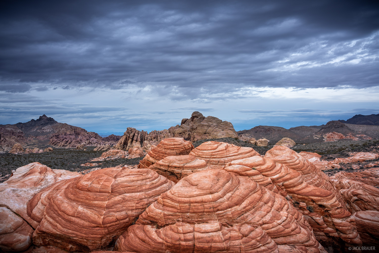 Stormy weather rolling in over sandstone formations.