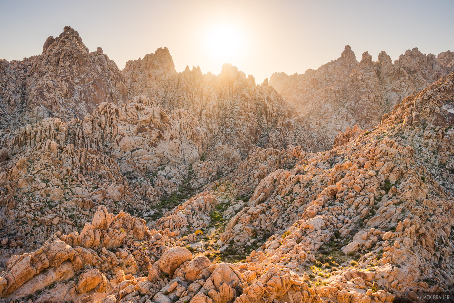 The sun sets over a super rugged bouldery basin high in the Coxcomb Mountains of Joshua Tree National Park, California.