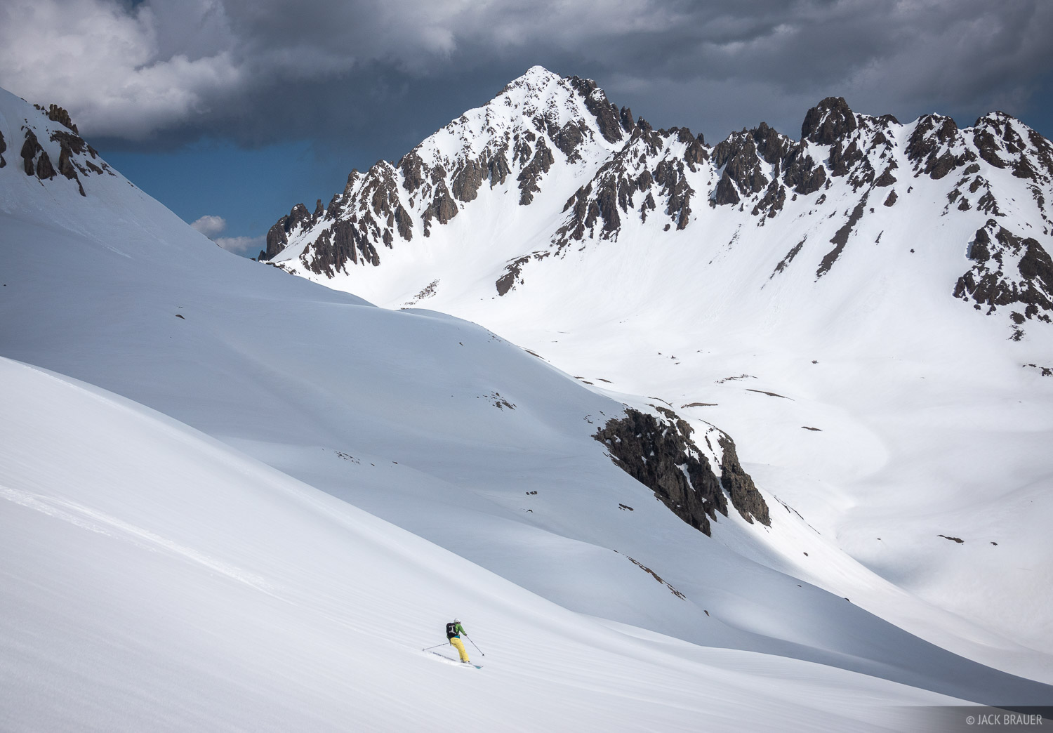 Claudia Brauer skis below Mt. Sneffels - June.