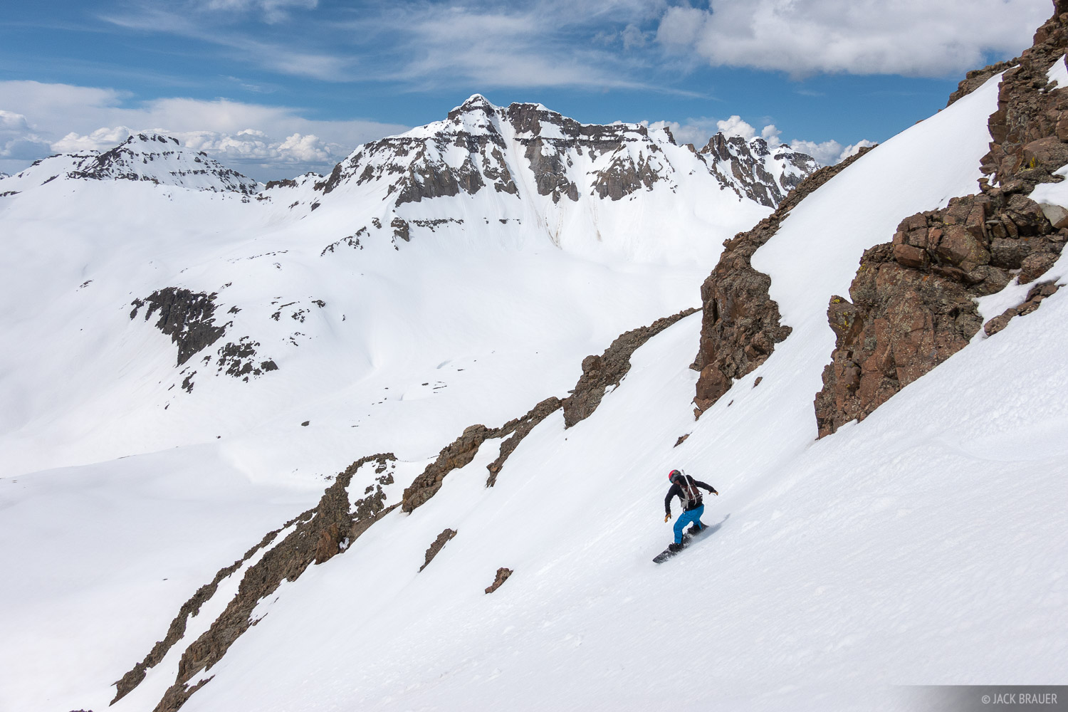 Parker McAbery rides a couloir in the Sneffels Range - June.